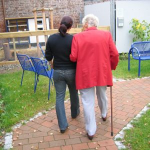 Younger woman and older woman walking together